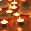 Burning candles and pebbles for aromatherapy session - Zdjęcie stockowe
