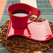 Cup of coffee with many beans around — Stock Photo #4643243