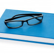 Reading glasses with books isolated on the white — Photo