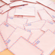 Mail concept with many envelopes on the table - Stock Photo