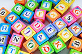 Learning and education concept - pile of alphabet blocks — Стоковое фото