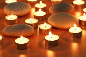 Burning candles and pebbles for aromatherapy session — Photo