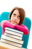 Young female student with many study books — Stock Photo
