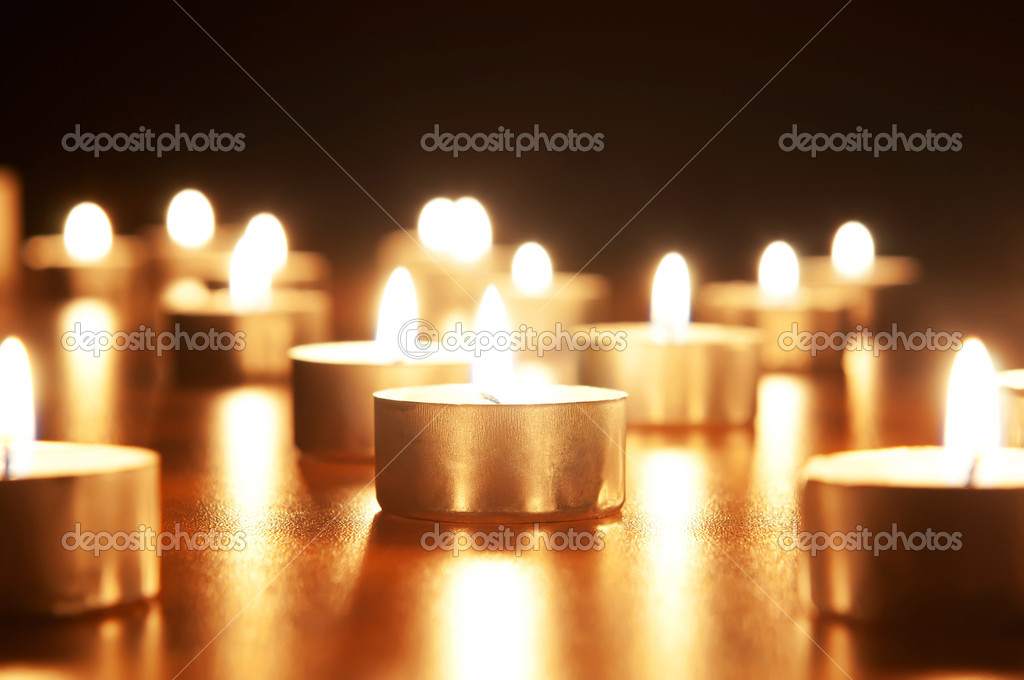 Many burning candles with shallow depth of field  Stock Photo #4642545