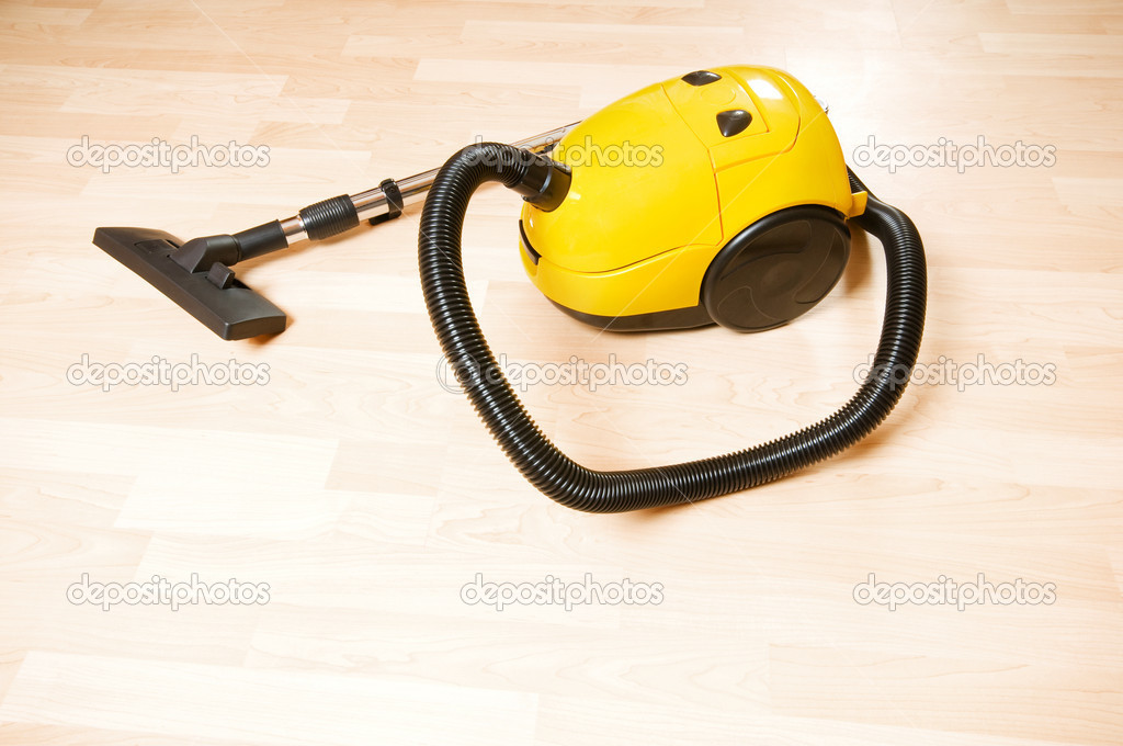 Vacuum cleaner on the polished wooden floor  — Stock Photo #4644562