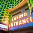 Casino entrance with big neon red letters - Stock Photo