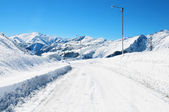 Snow road on the winter day — Stock Photo