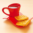 Cup of tea and fresh cookies on table - ストック写真