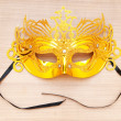 Ornate masks isolated on the wooden background - Stock Photo