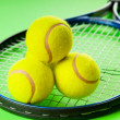 Tennis concept with balls and racket — Stock Photo #5097603