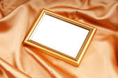 Picture frames on the color satin background — Stock Photo
