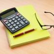 Business concept with notepad and calculator — Stock Photo