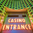 Casino entrance with big neon red letters - Photo