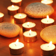 Burning candles and pebbles for aromatherapy session - Stockfoto