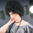 Stock Photo: Young attractive girl with afro curly haircut
