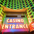 Casino entrance with big neon red letters — Stock Photo #5105718