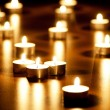 Many burning candles with shallow depth of field - Stock Photo
