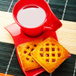 Cup of tea and fresh cookies on table — Stock Photo