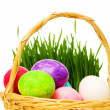 Royalty-Free Stock Photo: Eggs in the basket and grass isolated on white
