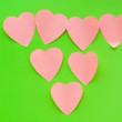Heart shaped sticky notes on the background — Stock Photo