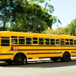 Stock Photo: Yellow school bus on street
