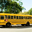 Yellow school bus on the street — Stock Photo #5107862