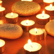 Burning candles and pebbles for aromatherapy session — Stock Photo