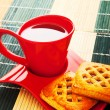 Stock Photo: Cup of tea and fresh cookies on table