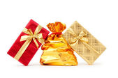Gift boxes and golden sacks — Stock Photo