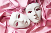 Theatre concept with the white plastic masks — Stock Photo