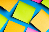 Reminder notes on the bright colorful paper — Stock Photo