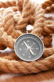 Compass and rope in travel and adventure concept — Stock Photo