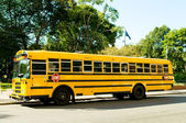 Yellow school bus on the street — Stock Photo