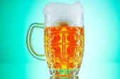 Beer glasses against the colorful gradient background — Stock Photo