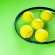 Tennis concept with balls and racket — Stock Photo #5124246