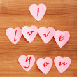 Heart shaped sticky notes on the background - Foto Stock