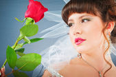 Beautiful bride with rose in studio shooting — Stock Photo