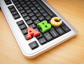 Early education concept with keyboard and letters — Stock Photo