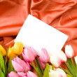 Envelope and flowers on the satin background — Stock Photo #5132385