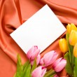 Envelope and flowers on the satin background — Stock Photo #5132392