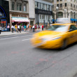 Stock Photo: Famous New York yellow taxi cabs in motion - intentional blur