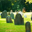 Cemetery with many tombstones on the bright day - Stock Photo