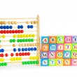 Alphabet blocks and abacus isolated on white — Stock Photo #5134266