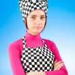 Young female cook against gradient background — Stock Photo #5134904