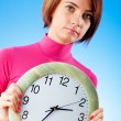 Young womholding round clock in hands — Stock Photo #5134929