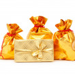 Stock Photo: Gift boxes and golden sacks