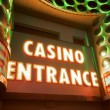 Casino entrance with big neon red letters — Stock Photo #5137100