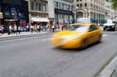Famous New York yellow taxi cabs in motion - intentional blur — Stock Photo