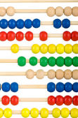 Education concept - Abacus with many colorful beads — Stock Photo