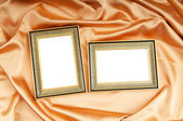 Picture frames on the color satin background — Foto de Stock